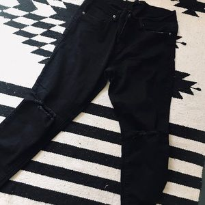 Black distressed skinny leg jeans